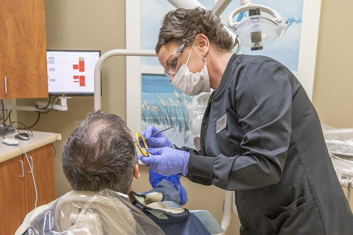 Seen here is Smiles Dental dental assistant Nicole Di Pietra preparing to take an x-ray of a patient. Photo by Mike Schultz