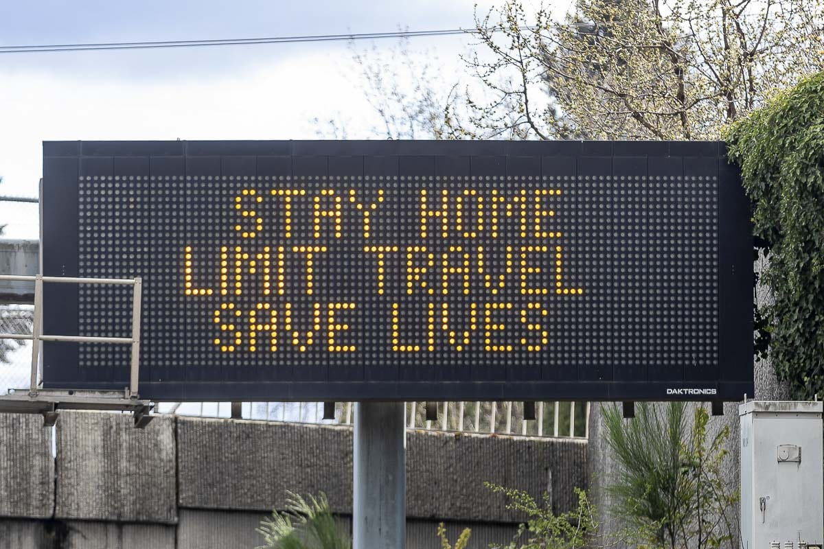A sign along I-5 in Vancouver urges motorists to stay home. Washington's Stay Home, Stay Healthy order was extended through May 4. Photo by Mike Schultz