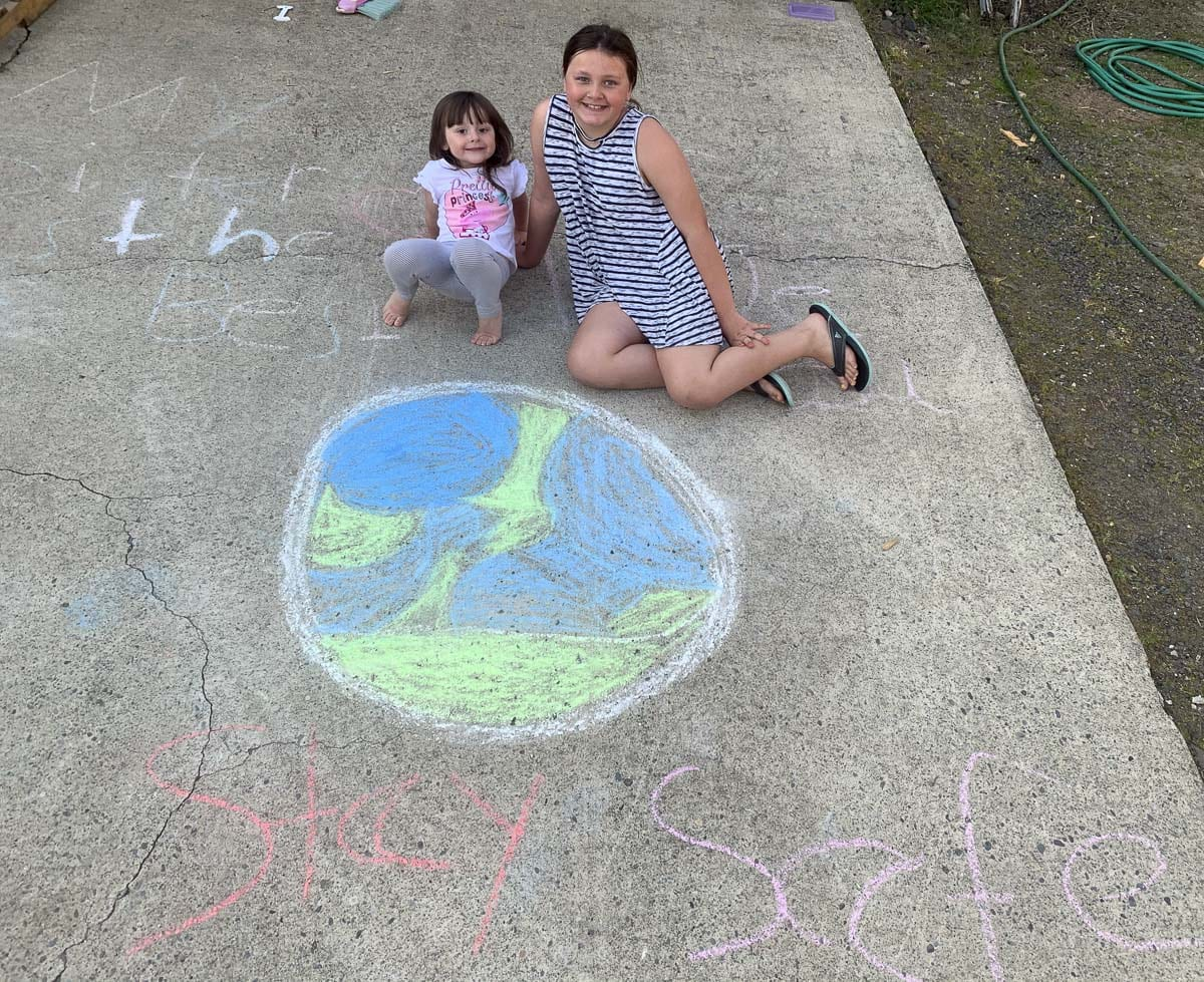 Students are encouraged to use sidewalk chalk to create art and games during The Great Woodland Chalk Out. Photo courtesy of Woodland Public Schools