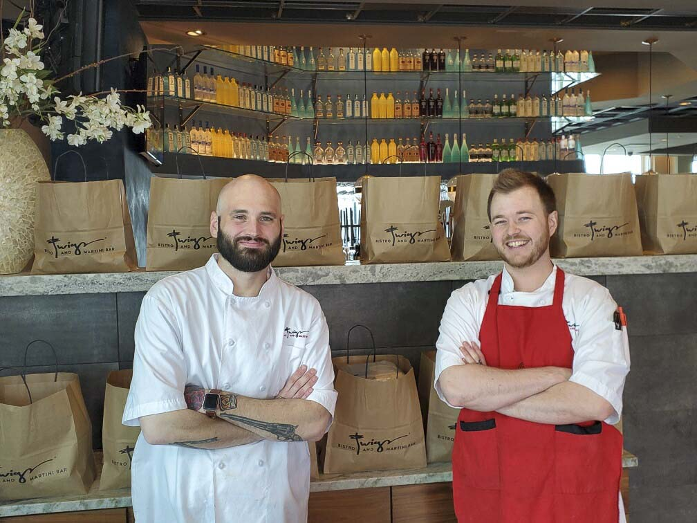 Twigs Bistro Executive Chef and Sous Chef, Spencer Spencer Galbraith and Teagan Moore, prepare meals for donation to area hospitals. Photo courtesy of Twigs Bistro