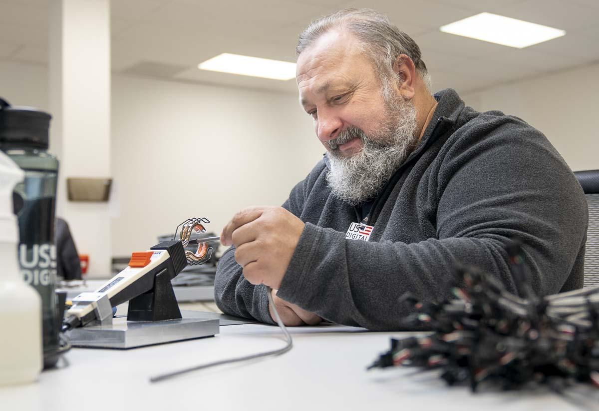 USD crew member Nick is seen here applying heat shrink tubing to cable at US Digital on Fri., April 3. Photo by Paul Suarez
