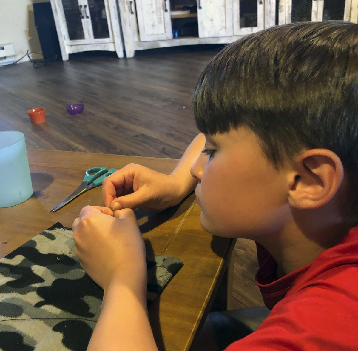 Logan Gnade, a 4th grader at North Fork Elementary School, used math and sewing to design patterns and sew face masks for friends and family. Photo courtesy of Woodland Public Schools