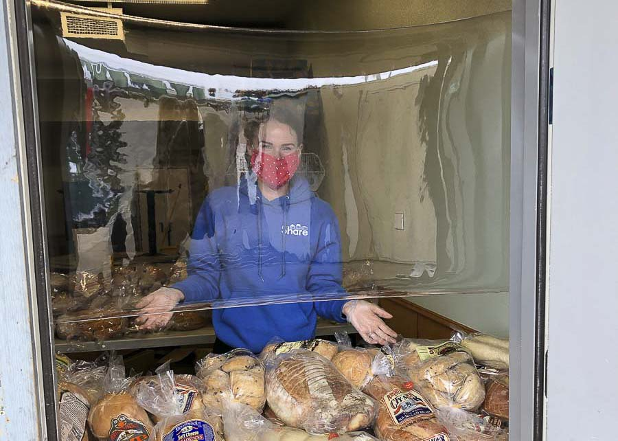 Bread loaves of bread are given out to the homeless and those in need at the Share location in Vancouver. Clear Plastic shields protect servers and customers. Photo courtesy of Share Vancouver