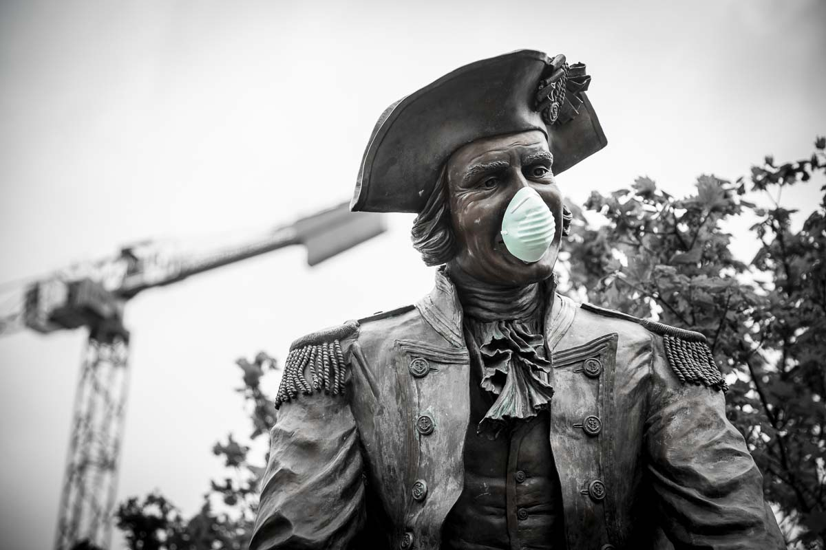 Captain Vancouver wears a mask placed on him by a passer by. Photo by Jacob Granneman