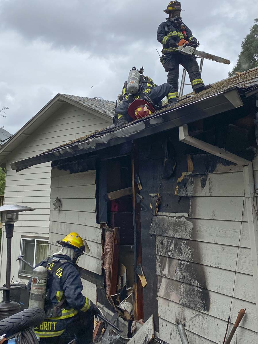 Crews from the Vancouver Fire Department successfully extinguished a garage fire Monday afternoon at a residence in Vancouver. Photo courtesy of Vancouver Fire Department