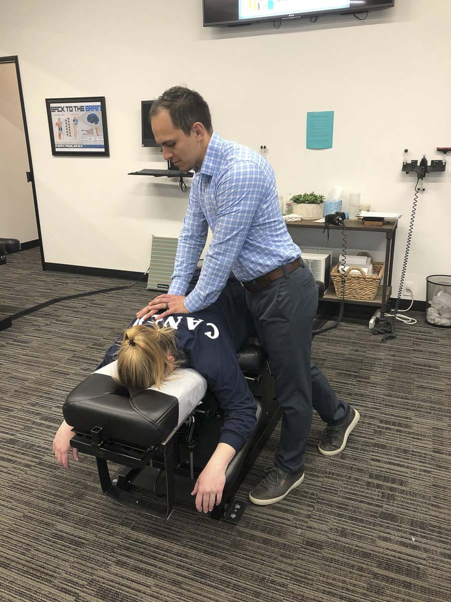 Bridge Chiropractic's Dr. Zach Fish is seen here adjusting a patient at the Salmon Creek clinic just off I-205 and I-5. Photo courtesy of Bridge Chiropractic