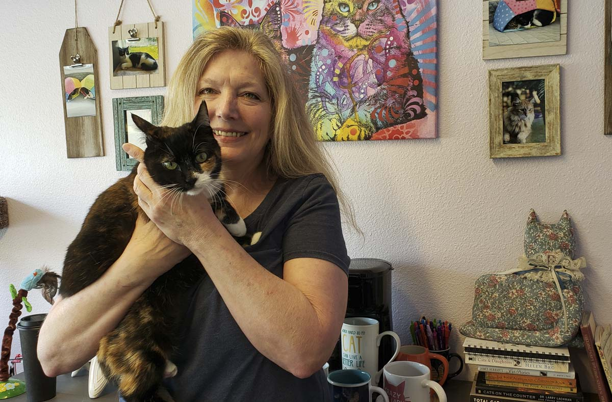 Margie McGhee opened her feline spa and boarding company, Cats Play While You're Away, last spring, turning her love for cats into a career. Photo by Paul Valencia