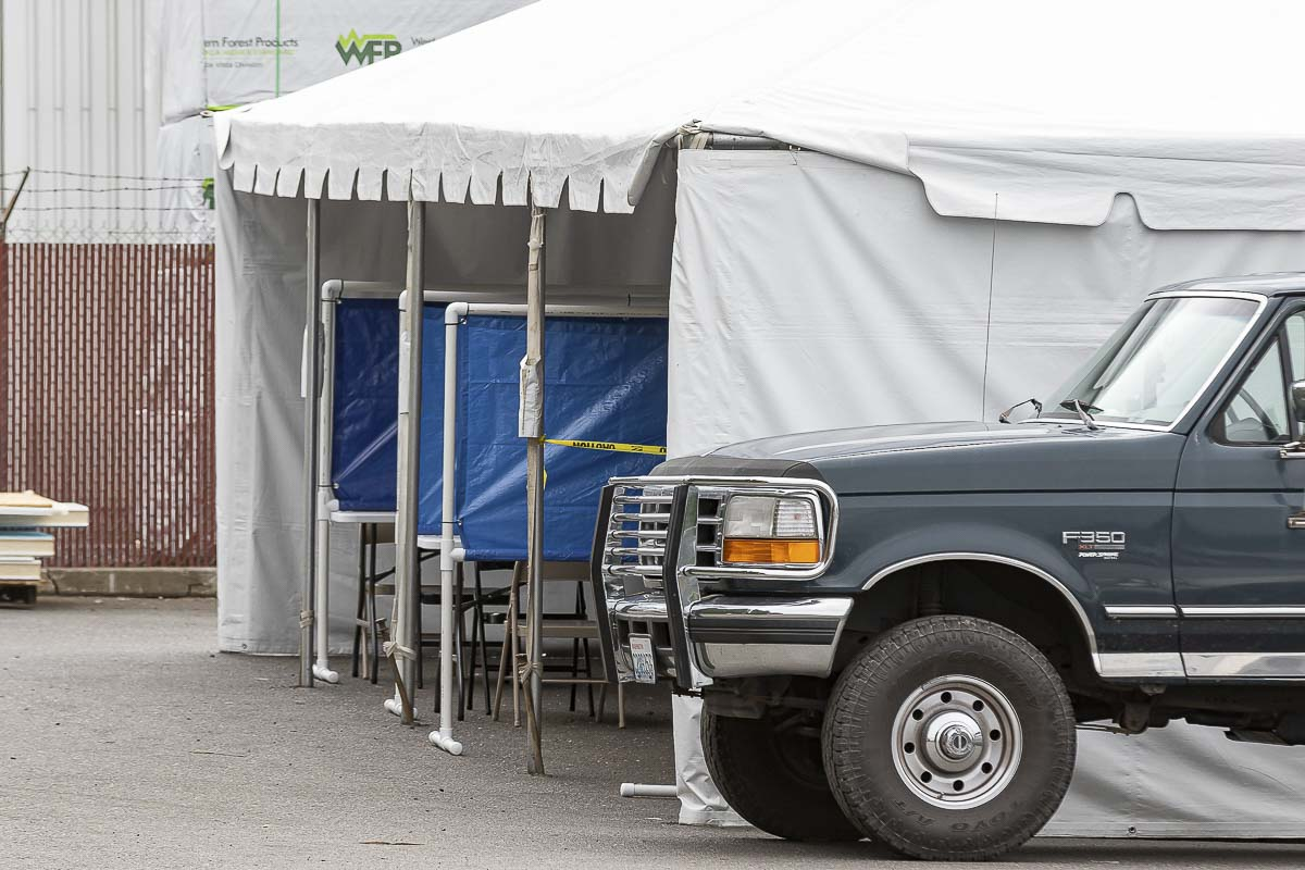 Firestone Pacific Foods in Vancouver has set up a tent outside with barriers where employees can eat lunch in an attempt to stop an outbreak of COVID-19 that has impacted at least 69 workers at the frozen fruit packing plant. Photo by Mike Schultz