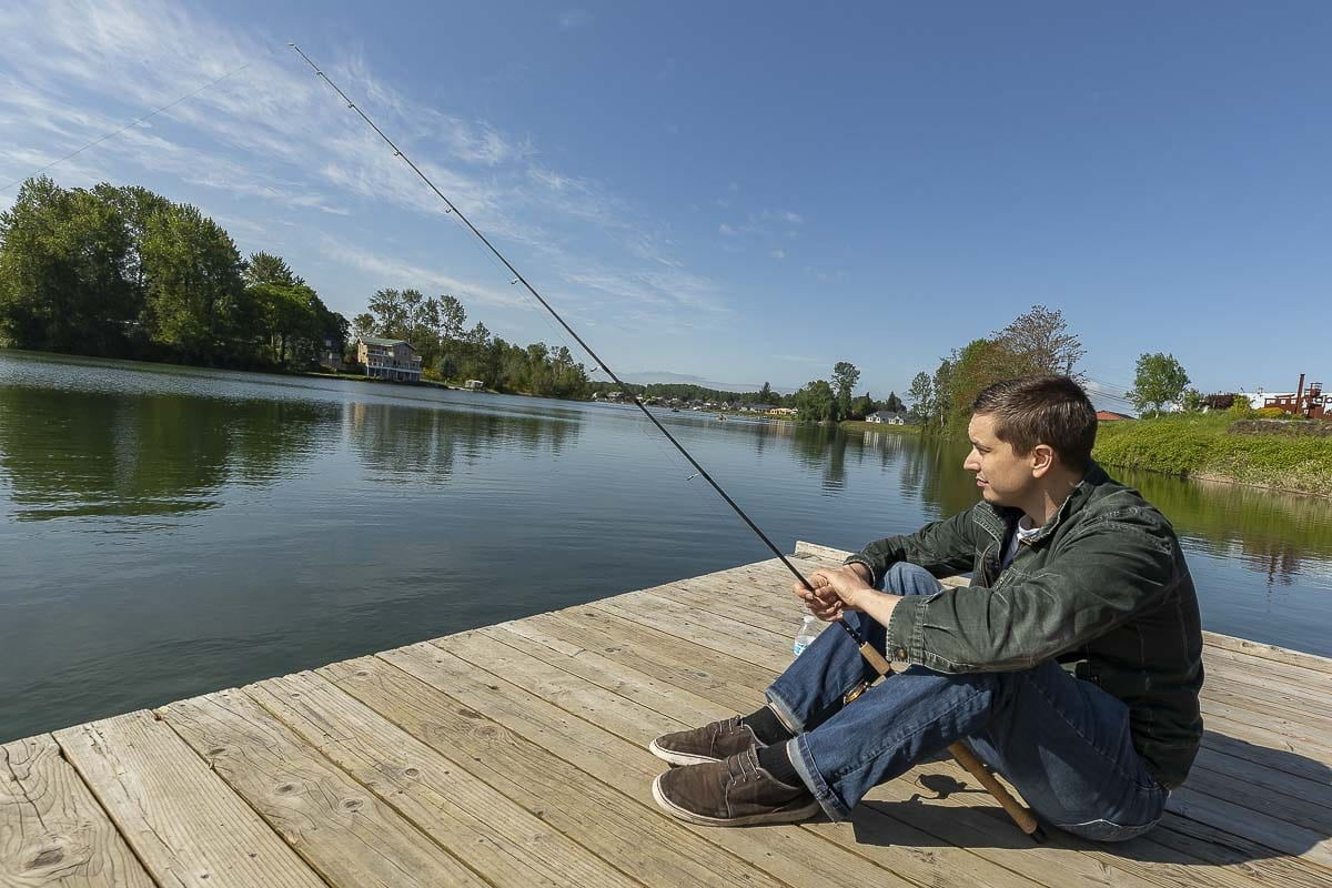Lucas Holmgren was among the local anglers who made it to Horseshoe Lake in Woodland for Tuesday's reopening of recreational fishing. Photo by Mike Schultz