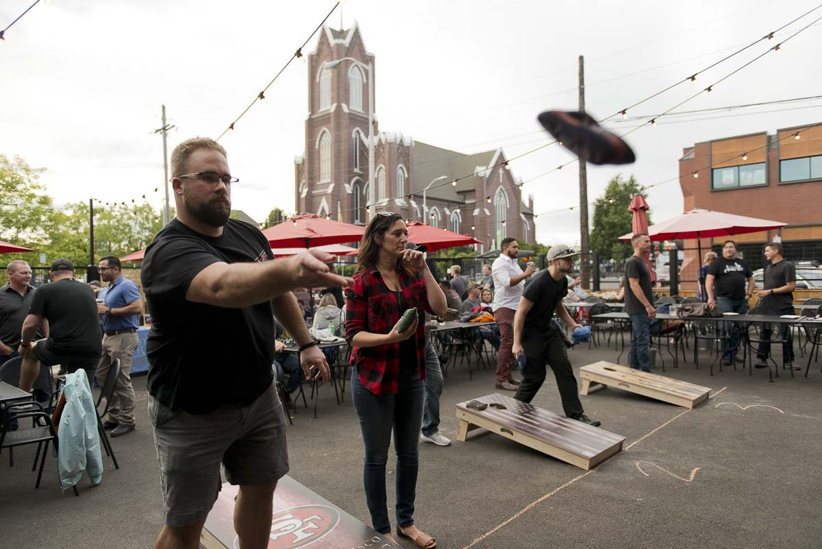 ontestants take their shots during a charity cornhole tournament organized by Heathen Brewing and a number of local nonprofit organizations. Photo courtesy of Community Foundation for Southwest Washington