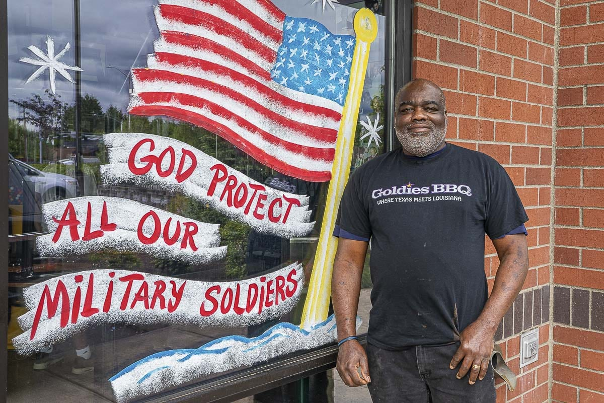 Charles Bibens is proud to show off his family's passions at his restaurant. Signage that says Jesus is the Reason and a salute to military and law enforcement decorate Goldies Texas Style BBQ. Photo by Mike Schultz