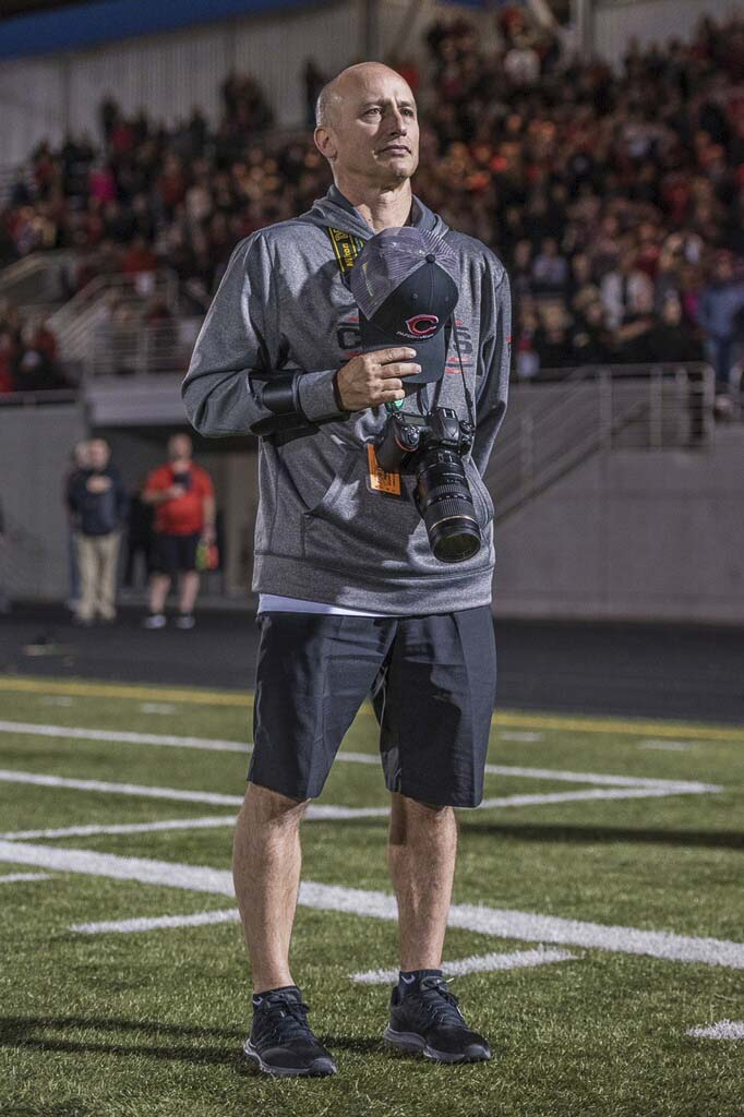 Kris Cavin turned a hobby into a passion. And, unofficially, became the official photographer of all that is Camas sports and more. Photo courtesy of Blake Schnell