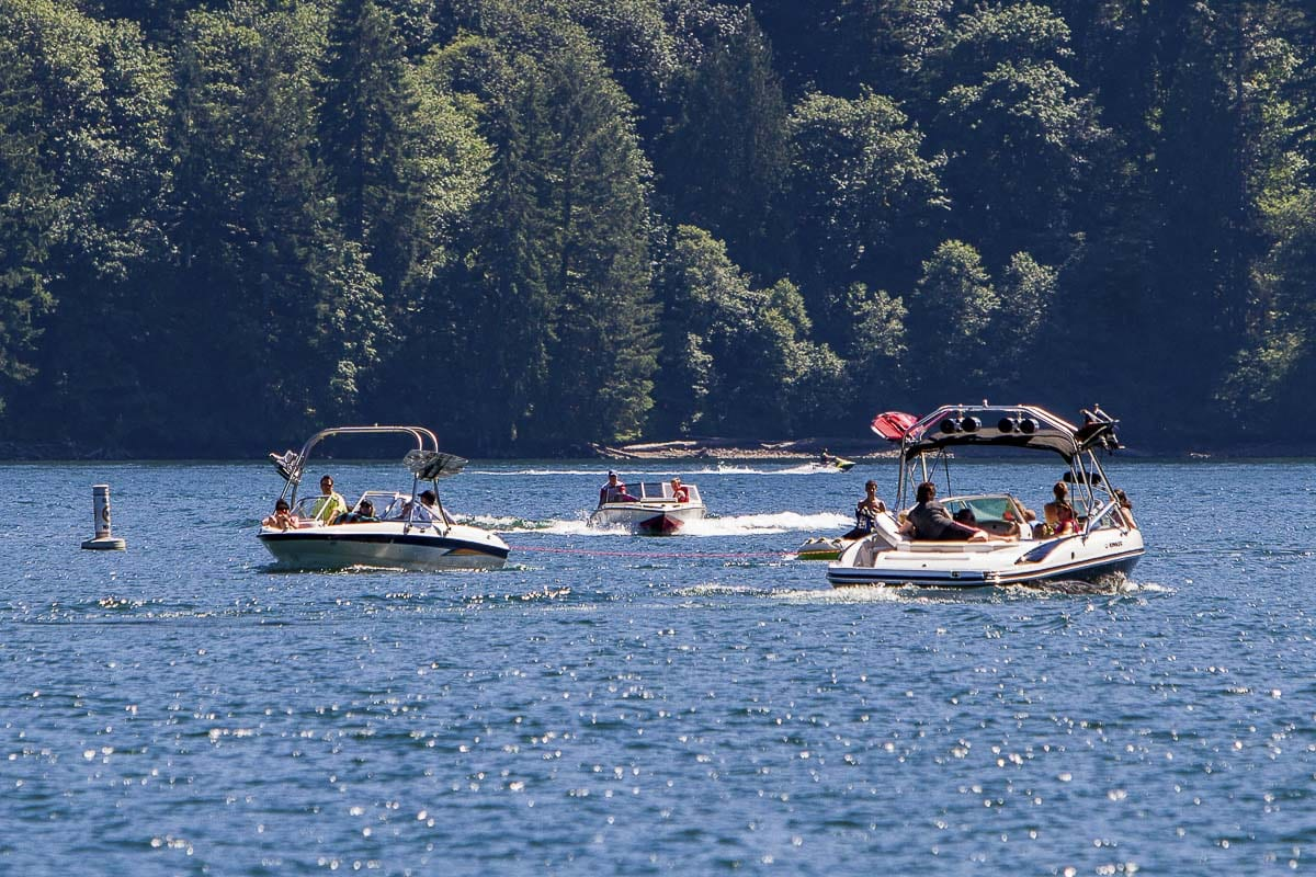 Public Health officials encourage everyone to follow a few simple strategies to stay safe while enjoying the water now and throughout the summer. In this file photo, area residents enjoy a sunny day on Lake Merwin. Photo by Mike Schultz