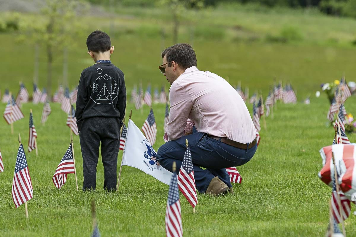 Families and friends may continue the tradition of placing flowers and small American flags at their veteran's gravesite. Photo by Mike Schultz