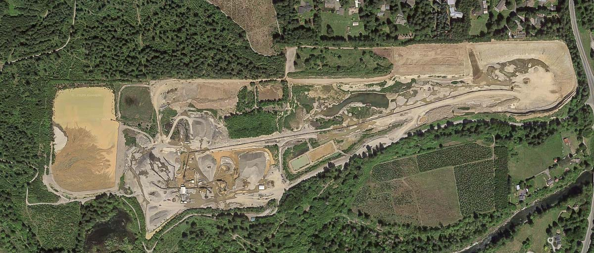 The Cadman Lewisville gravel pit as seen from above via Google Earth. The holding pond and related dam or dike can be seen off to the right. Photo by Google Maps