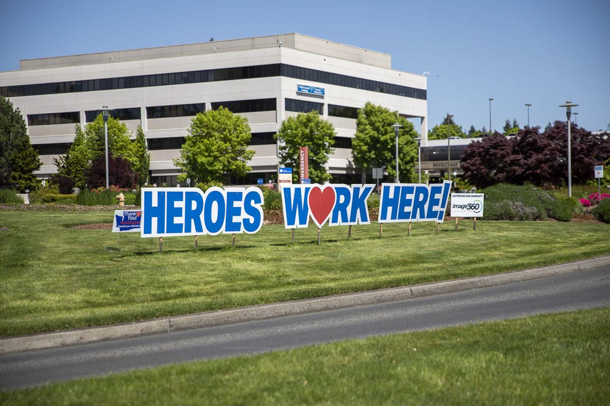 "The ""Heroes Work Here"" sign out front of PeaceHealth Southwest Medical Center was the first to be installed by Image360. Photo by Jacob Granneman"
