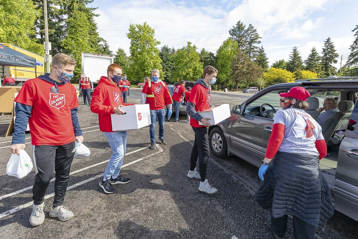 Members of The Church of Jesus Christ of Latter-Day Saints helped load vehicles with food boxes Friday at Vancouver Mall. Photo by Mike Schultz