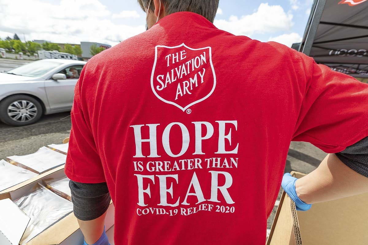 Volunteers at Friday's Food Box Distribution event displayed this theme on their T-shirts. Photo by Mike Schultz