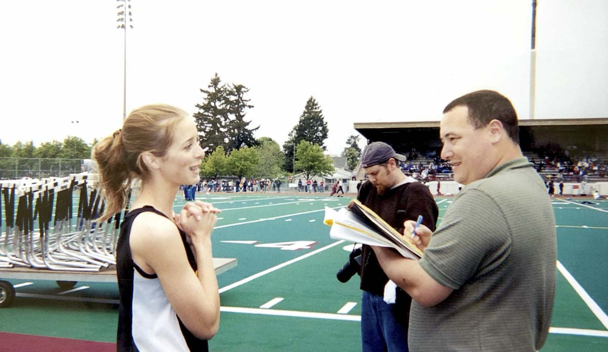 In this 2003 photo, Sarah Jackson, as she was known then, is interviewed by reporter Paul Valencia after Jackson won state titles for the Hudson's Bay Eagles. Now Sarah Panther, she is 35, living in California, and is an advocate for the chronically ill. Photo courtesy of the Jackson family