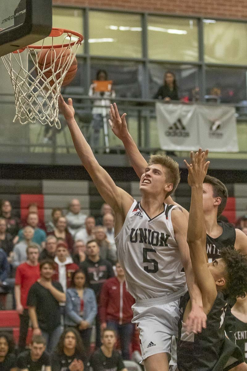 Union's Tanner Toolson will put basketball on hold for a couple of years while he goes on a mission for his church. When he returns to the game, he will play for Brigham Young University. Photo by Mike Schultz