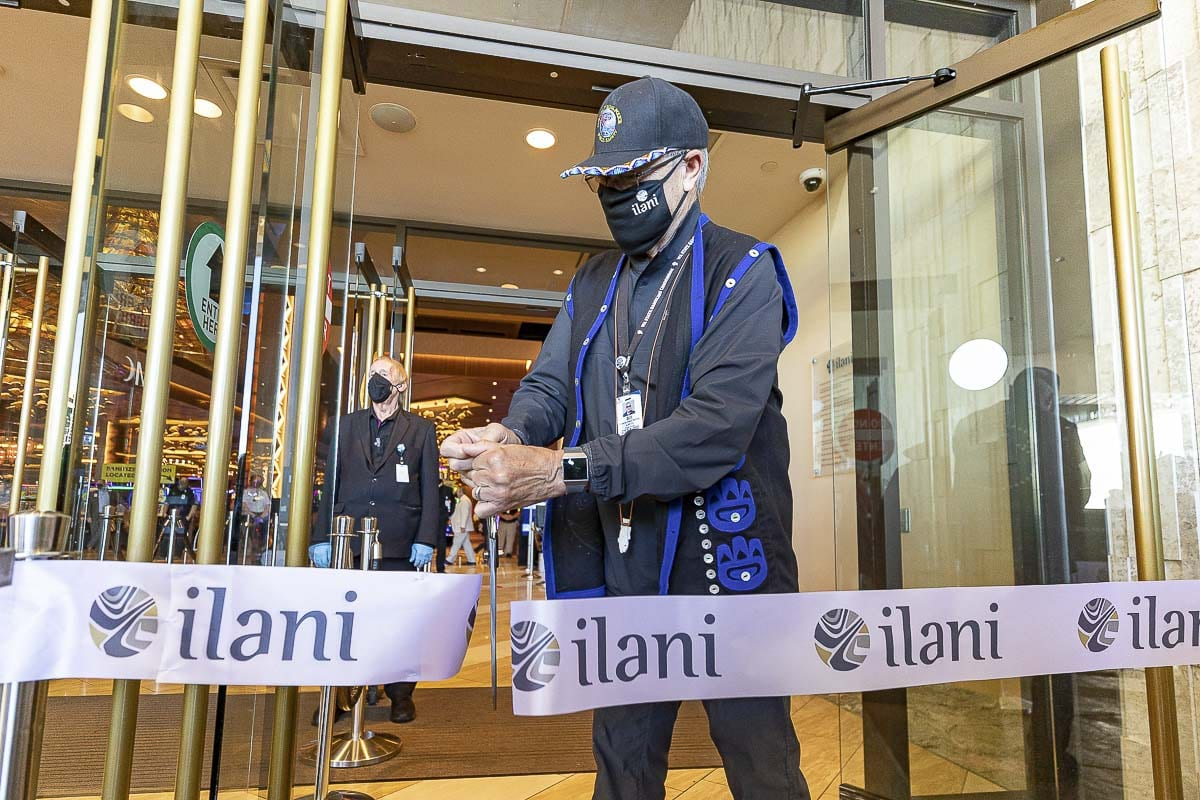 William Iyall, chairman of the Cowlitz Tribe, cuts a ribbon to reopen ilani. The center, which has gaming, restaurants, and shops, has been closed for 70 days. Photo by Mike Schultz