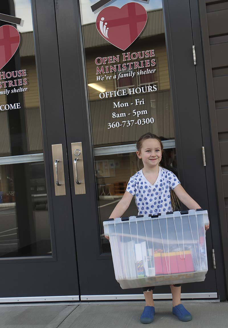 Frankie, an Artstra volunteer, delivers donated arts supplies to families at Open House's family shelter. Photo courtesy of Open House Ministries