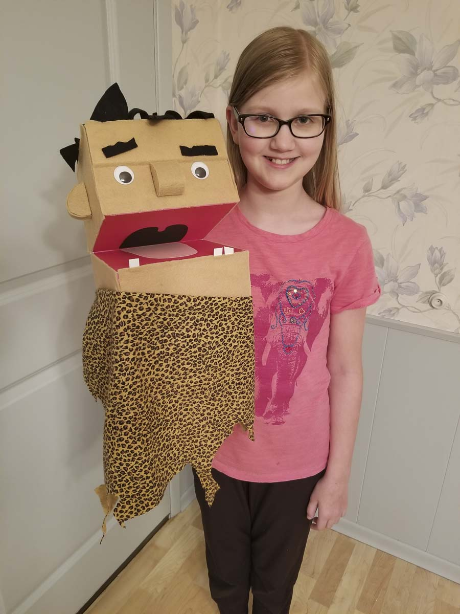 Young Lucy shows off her puppet as part of one of Journey Theater's online classes. Photo courtesy of Journey Theater