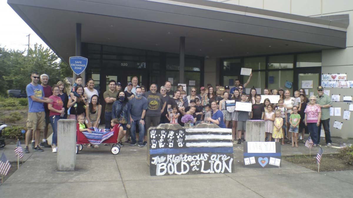 Members of the Vancouver community showed up Wednesday to the Vancouver Police Department's East and West Precincts to show their support for members of the department. After the events were over, they were upset to learn that all of the evidence off their support had been removed from the exterior of the precincts. Photo courtesy of lawenforcementtoday.com