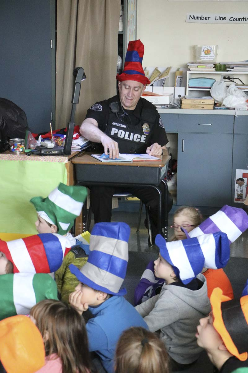 BGPS SRO Phil Anderson reads Dr. Suess books to students as part of Read Across America Day in March, 2018. Photo courtesy Battle Ground Public Schools