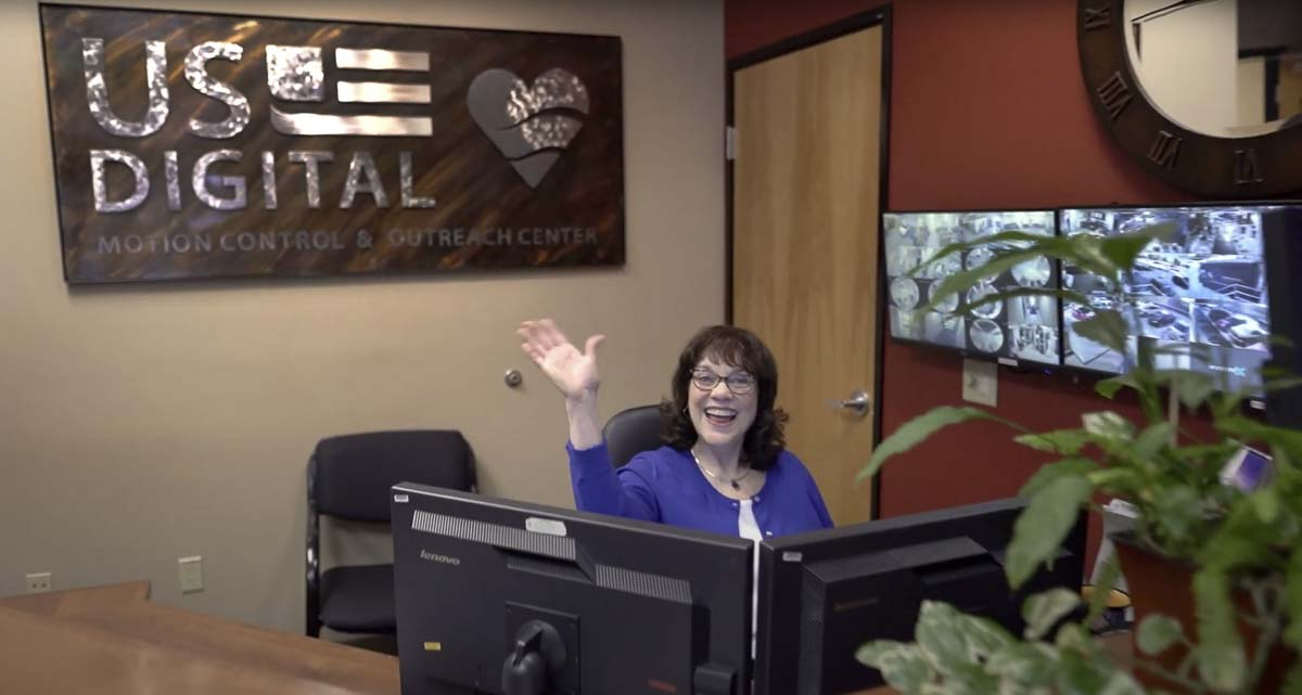 Diane Olmsted, shown here in this 2019 photo, is all smiles and offers a wave to just about everyone who visits the US Digital Outreach Center. Olmsted has watched the outreach center grow from the idea stage to where it is today, with 40 ministries using the office space. Olmsted is retiring July 1. Photo courtesy US Digital