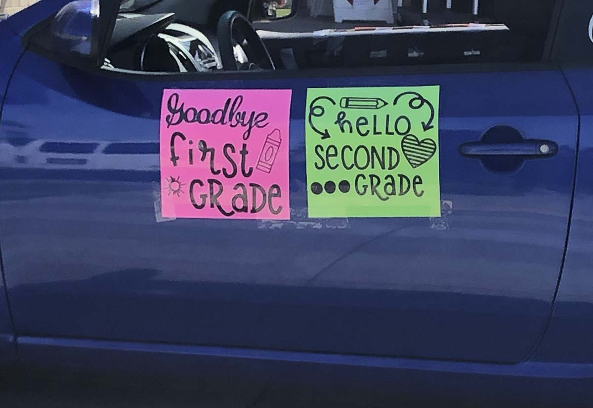 "A sign on a teacher's car at Union Ridge Elementary's car parade recognizes students' ""graduating"" to the next grade. Photo courtesy of Ridgefield Public Schools"