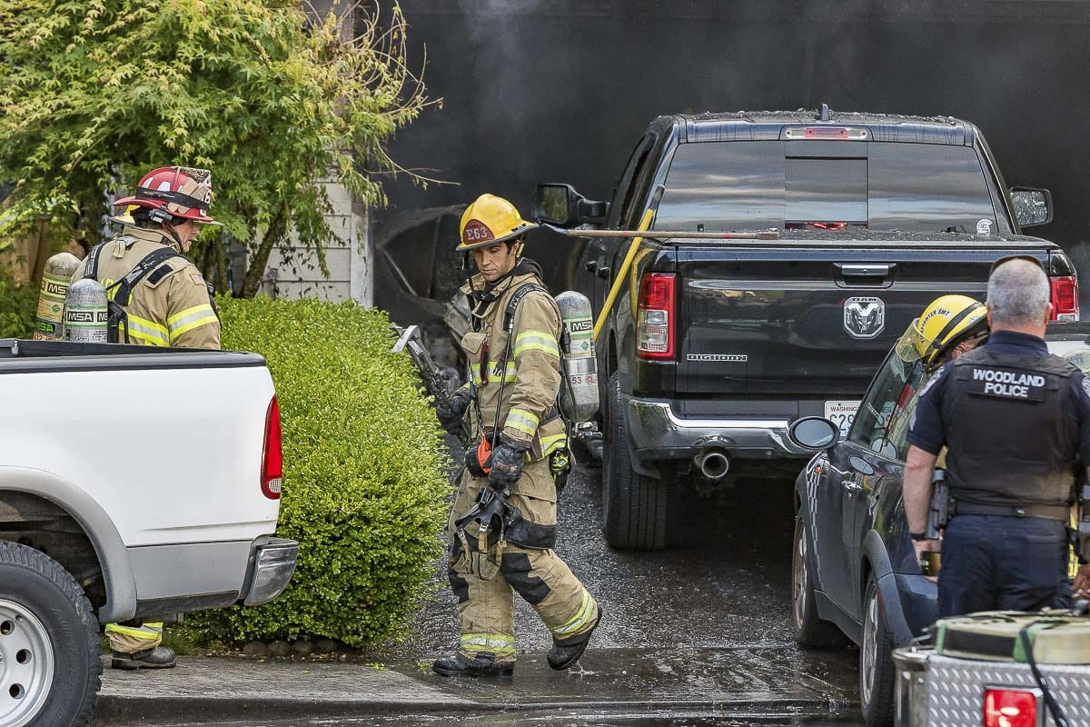 Callers told dispatchers that ammunition or fireworks were exploding in the garage. Firefighters could hear the small explosions when they first arrived on scene. Photo by Mike Schultz