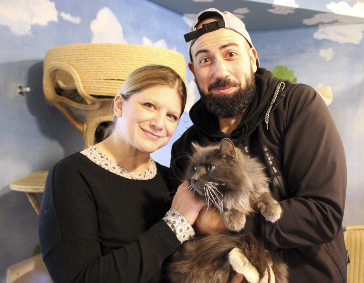 Jenn and Mike Morris are shown here with their Furry Friend. Photo courtesy of Furry Friends