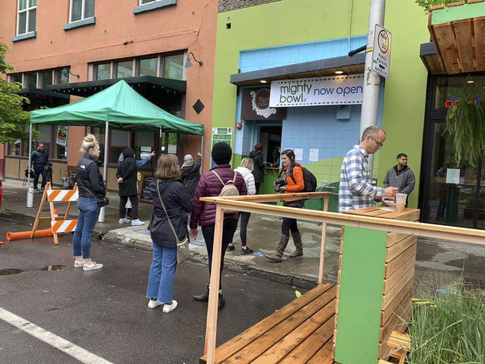 Customers line up outside The Mighty Bowl restaurant in downtown Vancouver on Tuesday. The Thai food eatery had been closed since mid-April. Photo courtesy The Mighty Bowl/Facebook