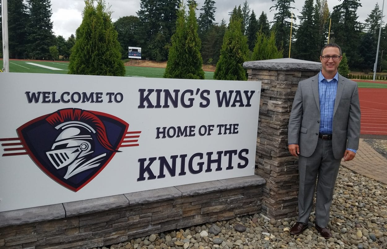 King's Way Christain Schools Superintendent Dr. Jason Tindol stands next to the school's outdoor sign. Clark County Today file photo