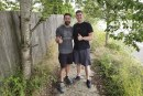 Clearing a path: Council member and son get to work