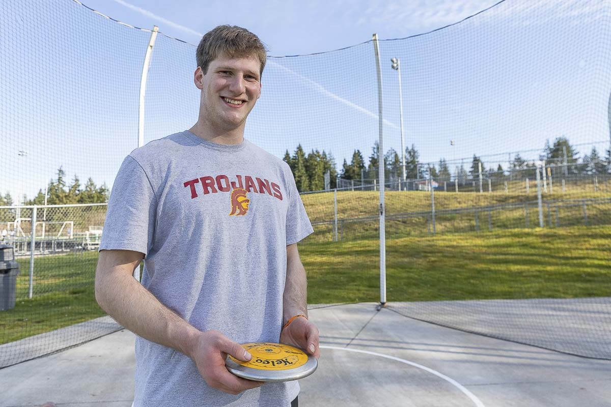 Trey Knight of Ridgefield set another record over the weekend. He is the nation's best high schooler in the hammer throw. Shown here with a discus back in March, Knight also was named the Gatorade's state boys Athlete of the Year in track and field. Photo by Mike Schultz