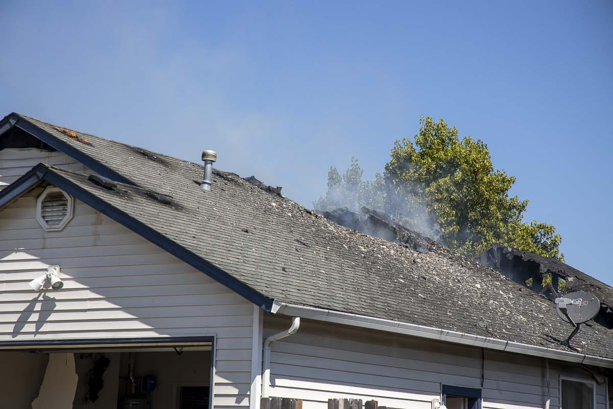 This home in Battle Ground was a complete loss after a fire on Monday. Photo by Chris Brown