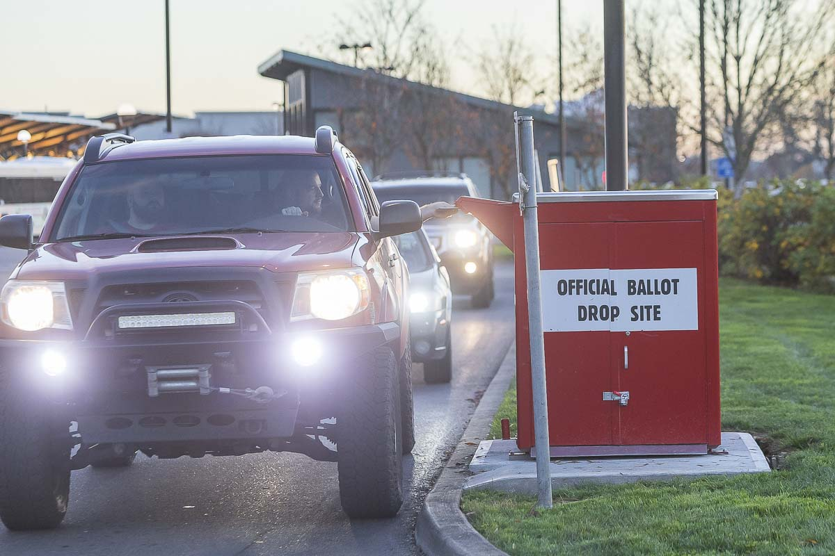Residents are seen here driving through a ballot box in Hazel Dell during a previous election day. Clark County Today file photo