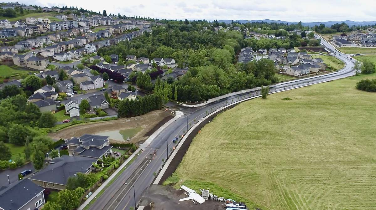 Brady Road is seen from the air here, as it winds past fields and subdivisions in Camas. The paving is one of the last steps for project completion. Photo courtesy of the city of Camas