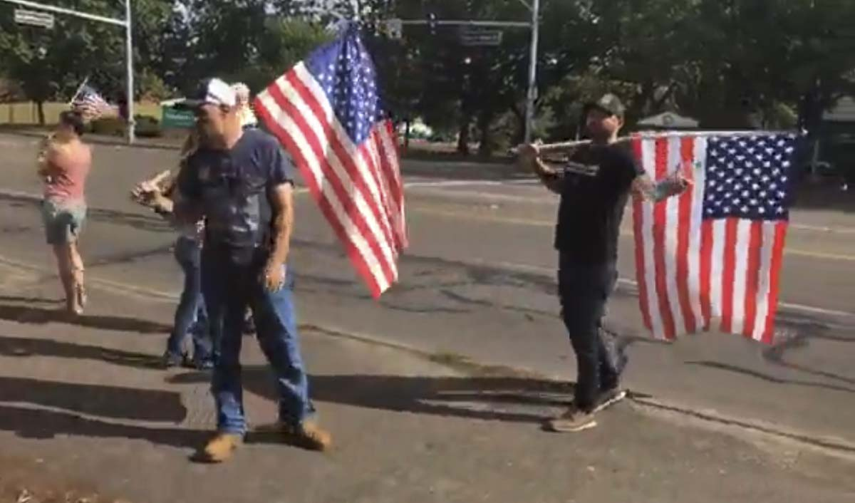 A group of protestors, including Patriot Prayer's Joey Gibson, rally outside of the Clark County Public Health building on Thursday. Screenshot from People's Rights Washington Facebook livestream