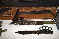 Detectives executed a search warrant at the suspect's hotel room and located what appears to be a kidnappers kit which included heavy duty flex cuffs, handcuffs, duct tape, rubber gloves, face wrap/blindfold, lubricant, a sex toy, several large knives, a hatchet, and a .45 caliber handgun and ammunition. Photo courtesy of Vancouver Police Department