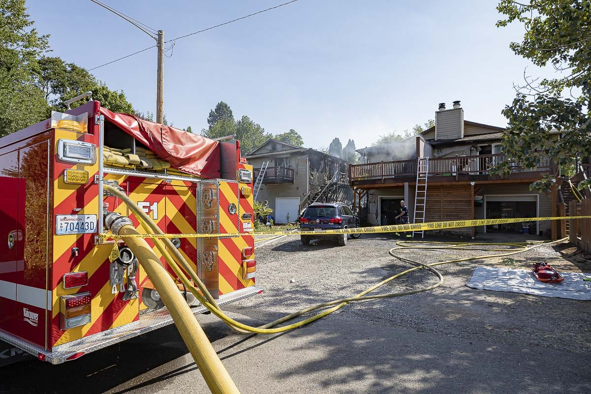 Just after 9 a.m. Friday, Vancouver Fire Department crews were dispatched to the report of a fire at a pair of duplexes in the 3600 block of Olive Street. Photo by Mike Schultz