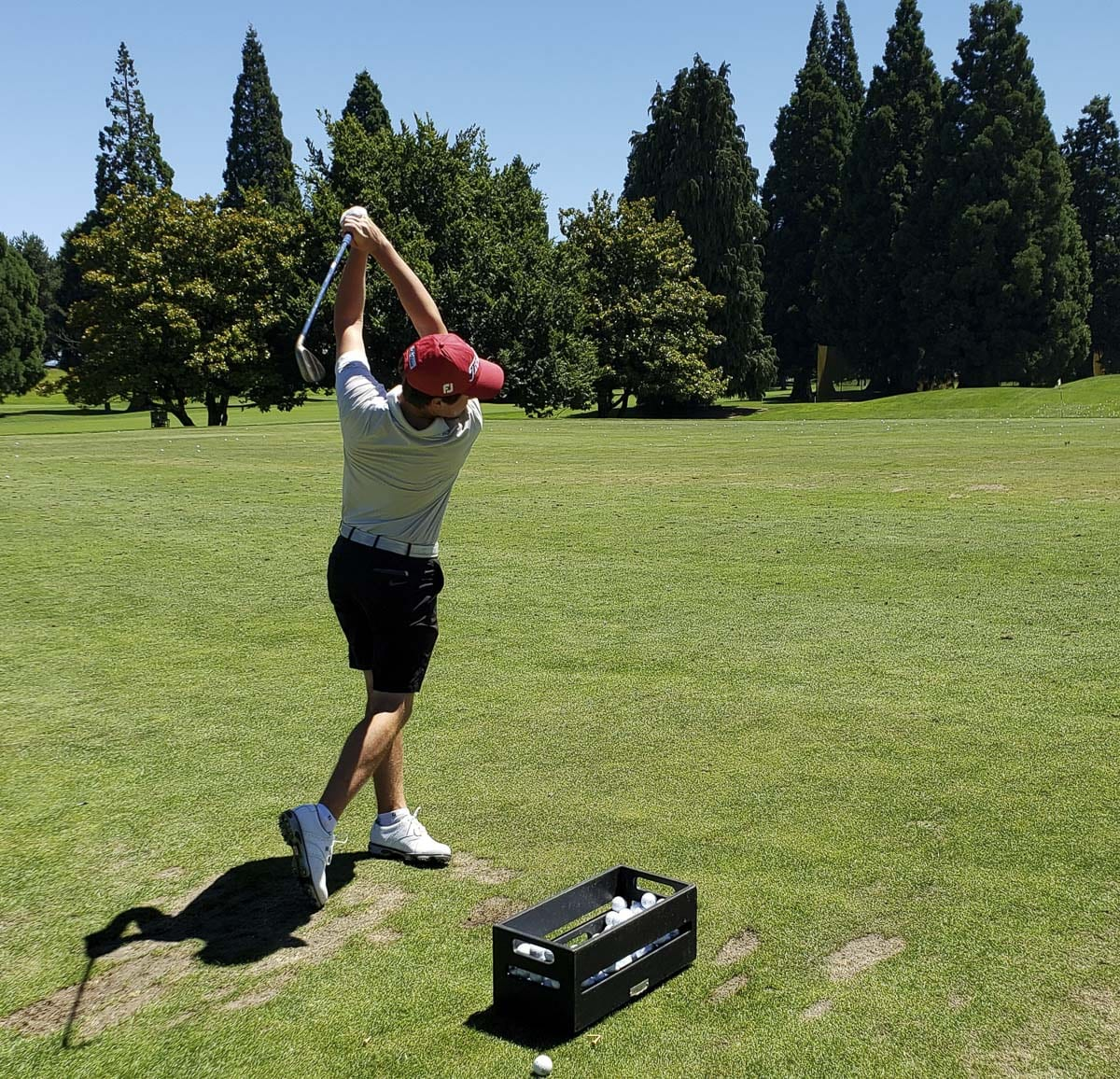 Graham Moody, shown here at a practice range in June, won the Oregon Junior Am last week. Photo by Paul Valencia