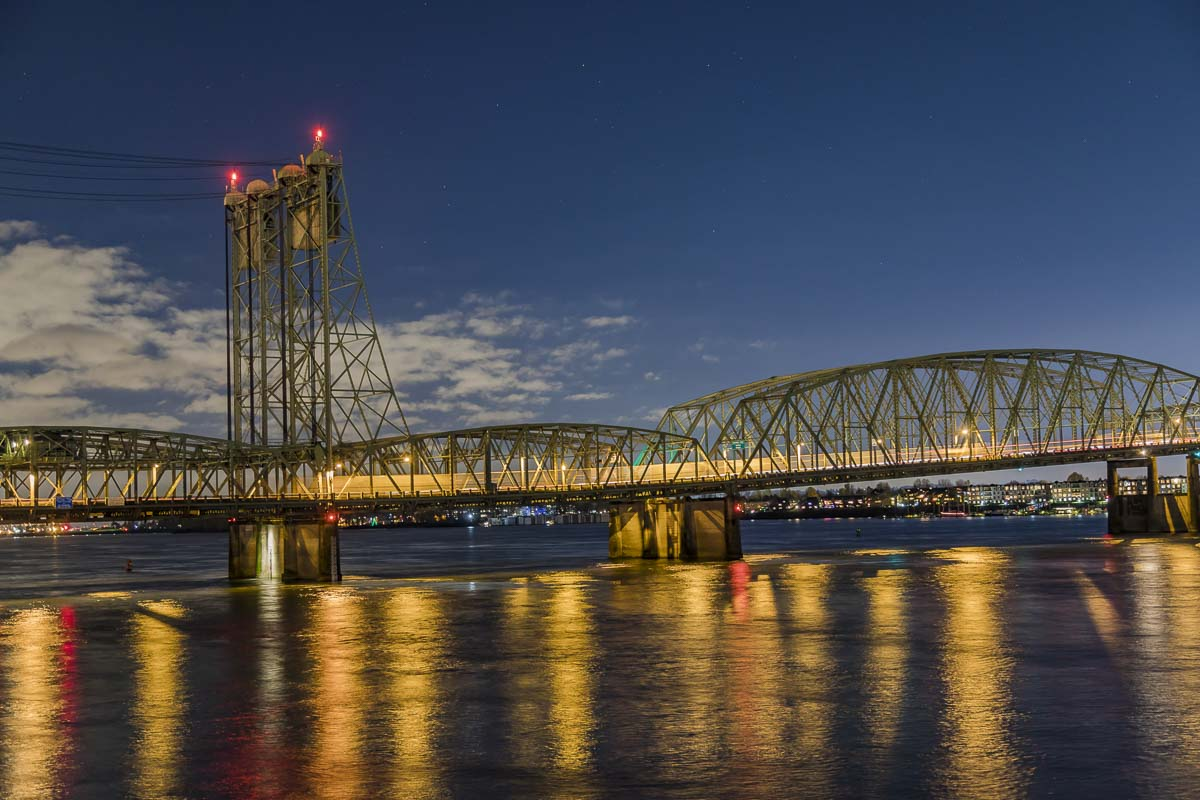 The I-5 Bridge, seen here at night, will be closed on it's northbound side in September for nine days. A 100-year-old trunnion will be replaced during that time. Photo by Mike Schultz