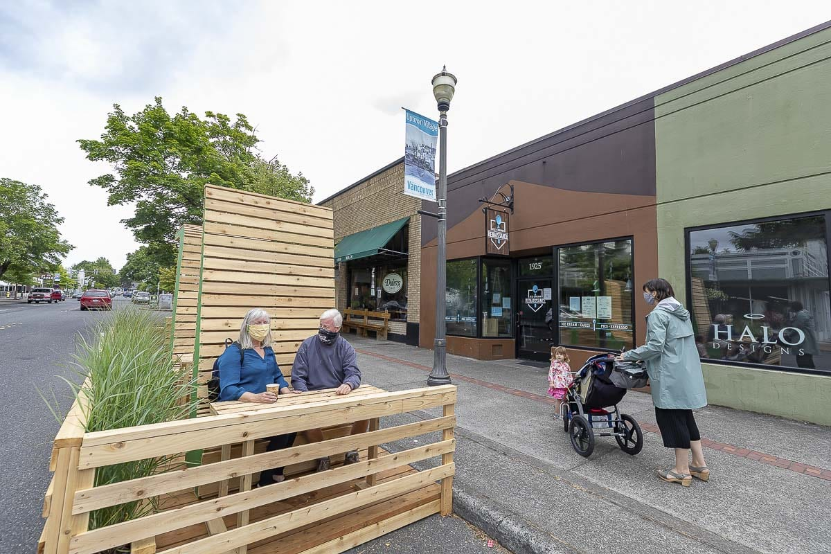 Two unnamed Vancouver residents enjoy a treat at a parklet built outside of Ice Cream Renaissance in downtown Vancouver. Photo by Mike Schultz