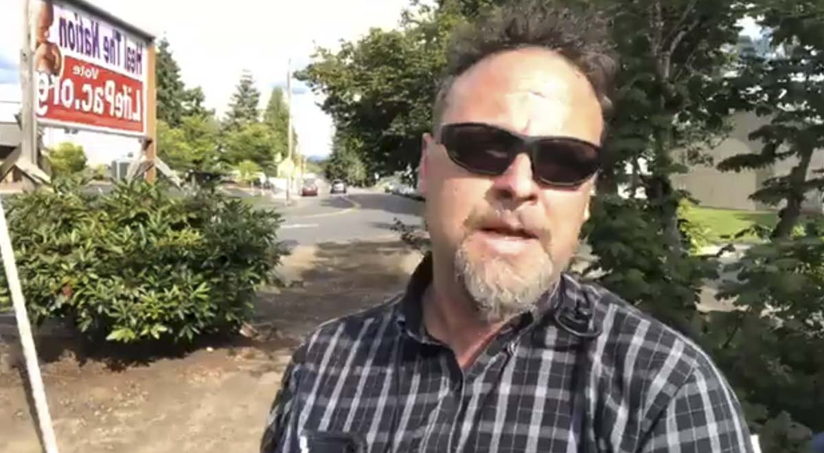 Rob Anderson speaks during a Facebook livestream of a protest outside the Clark County Public Health building. Screenshot from People's Rights Washington Facebook livestream