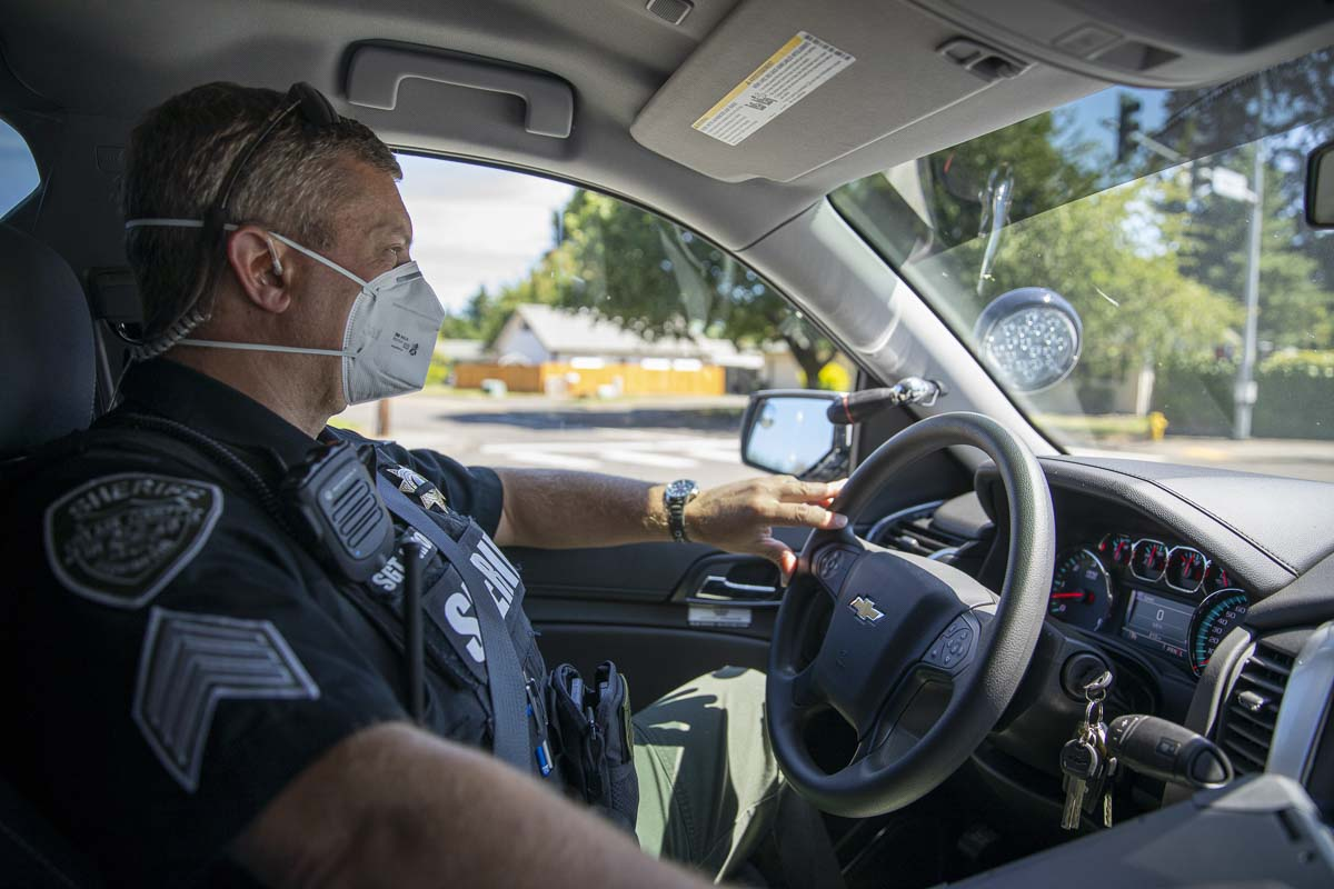 Clark County Sheriff's Office Sgt. Alex Schoening in his patrol vehicle during the Target Zero motorcycle awareness campaign this month. Photo by Jacob Granneman