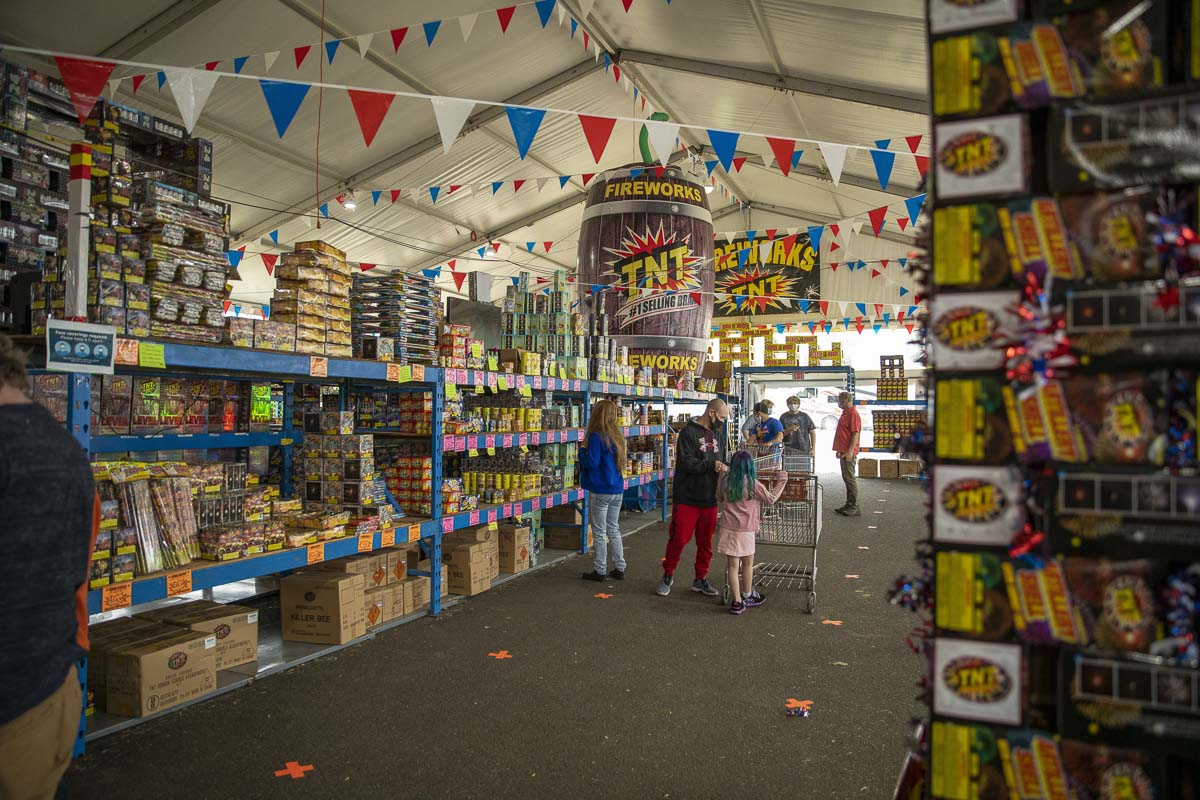 Shoppers can be seen here purchasing fireworks at the TNT Fireworks Warehouse in Vancouver. The massive tent had an opening day eight times larger than last year. Photo by Jacob Granneman