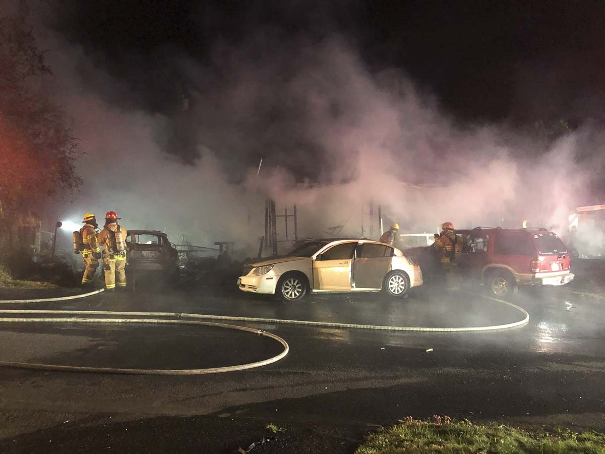 Clark County Fire & Rescue crews work to extinguish vehicles and a mobile home early Friday morning in Ridgefield. Photo courtesy of Clark County Fire & Rescue